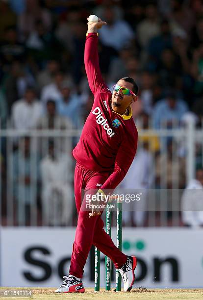 Sunil Narine of West Indies bowls during the first One Day International match between Pakistan and West Indies at Sharjah Cricket Stadium on...