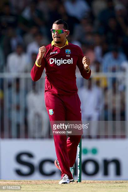 Sunil Narine of West Indies celebrates the wicket of Shoib Malik of Pakistan during the first One Day International match between Pakistan and West...