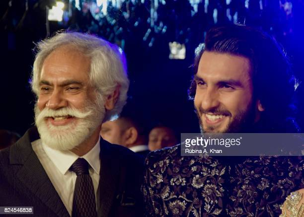 Sunil Sethi President Fashion Design Council of India with Bollywood actor Ranveer Singh at the FDCI's India Couture Week 2017 at the Taj Palace...