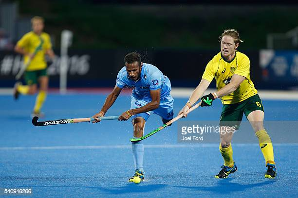 Sunil Sowmarpet if India is tripped by Matt Dawson of Australia FIH Men's Hero Hockey Champions Trophy 2016 final between Australia and India at...
