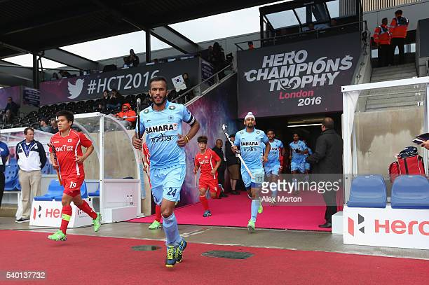 Sunil Sowmarpet of India and Hyosik You lead their teams out during the FIH Mens Hero Hockey Champions Trophy match between India and South Korea at...