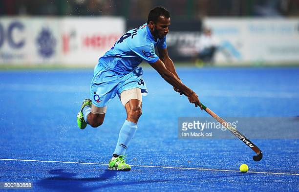 Sunil Sowmarpet of India runs with the ball during the match between Netherlands and India on day ten of The Hero Hockey League World Final at the...