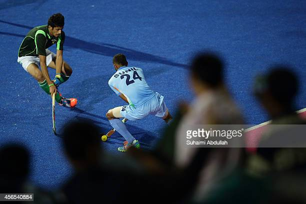 Sunil Sowmarpet Vitalacharya of India in action during the menÕs hockey gold medal match on day thirteen of the 2014 Asian Games between India and...
