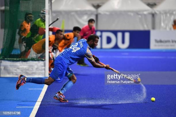Sunil Sowmarpet Vitalacharya of India shoots during Men's Hockey Semifinal match between Malaysia and India at GBK Senayan on day twelve of the Asian...