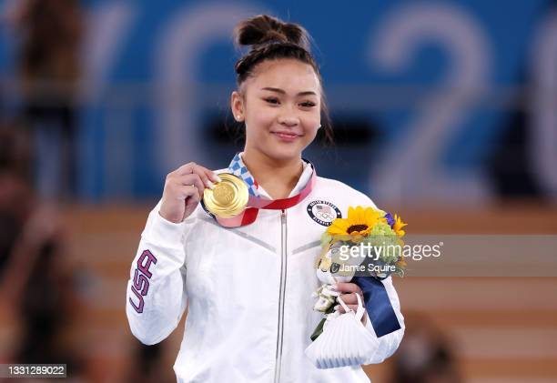 Sunisa Lee of Team United States poses with her gold medal after winning the Women's All-Around Final on day six of the Tokyo 2020 Olympic Games at...