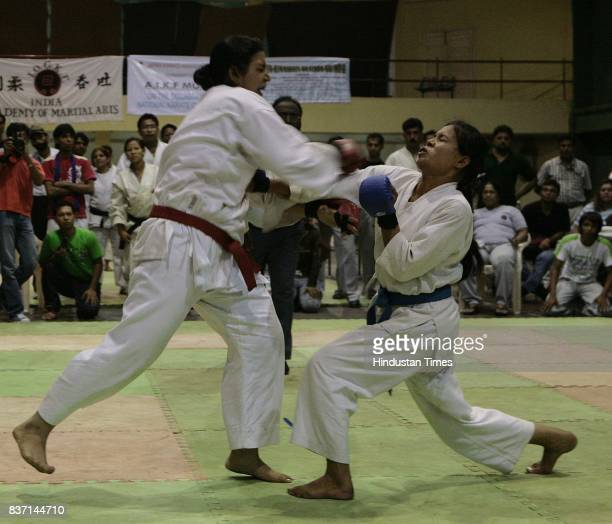 Sunita Chanu from Manipur who wins against Roshneesh Maneck from Maharashtara in All India Karate Championship match at Andheri Sports Complex