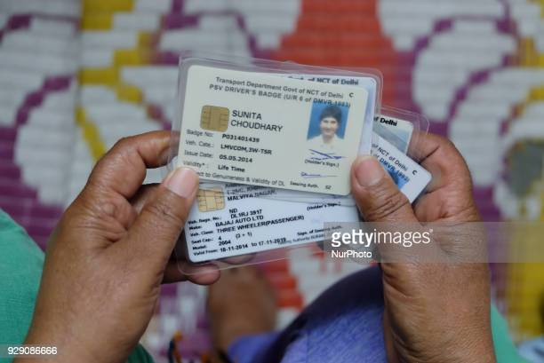 Sunita Choudhary 40 North India's first autorickshaw driver holds her various driving permits secured by her over the years on 7th March 2018 She...