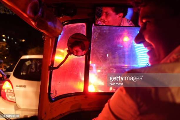Sunita Choudhary 40 North India's first autorickshaw driver smiles while interacting with her passengers during a ride in Central Delhi on 6th March...