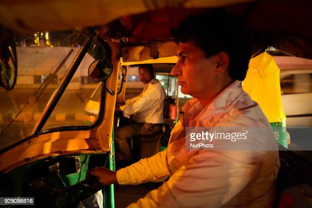 Sunita Choudhary North India's first autorickshaw driver driving at night in Central Delhi on 6th March 2018 Sunita Choudhary North India's first...