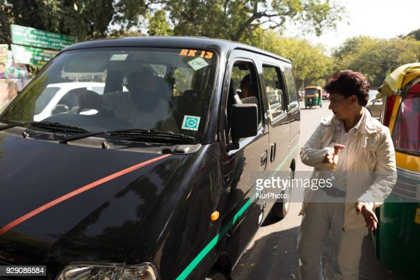 Sunita Choudhary North India's first autorickshaw driver guides a taxi driver to their destination as they stop to seek directions along a street on...
