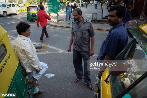 Sunita Choudhary North India's first autorickshaw driver interacts with male autorickshaw drivers waiting for customers outside Patel Chowk metro...