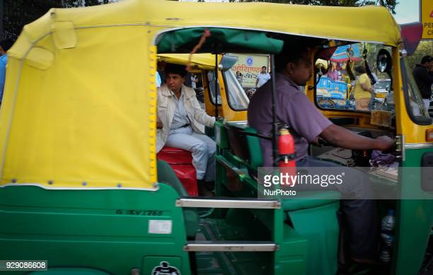 Sunita Choudhary North India's first autorickshaw driver sits in her autorickshaw while waiting for customers outside Patel Chowk metro station in...