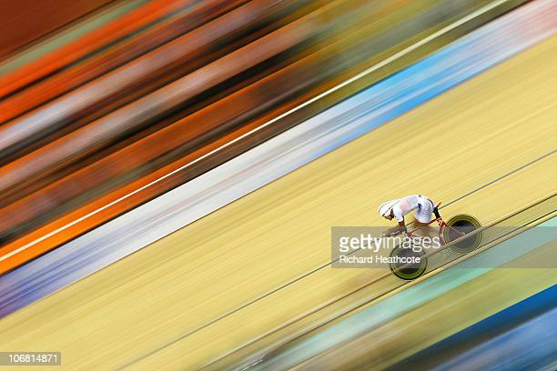 Sunjae Jang of South korea sets an Asian Games record in the Men's indivdual Pursuit at the Guangzhou Velodrome during day two of the 16th Asian...