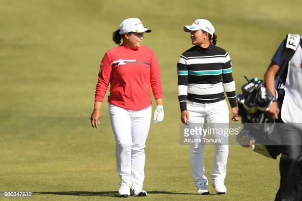 SunJu Ahn of South Korea and Ai Suzuki of Japan walk on the 18th hole during the final round of the Tokohama Tire PRGR Ladies Cup at Tosa Country...