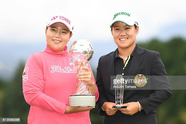 SunJu Ahn of South Korea and Nasa Hataoka of Japan pose with the trophy after the Stanley Ladies Golf Tournament at the Tomei Country Club on October...