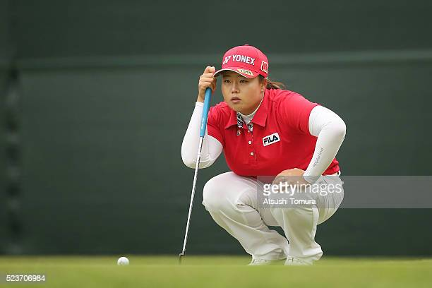 SunJu Ahn of South Korea lines up her putt on the 18th hole during the final round of the Fujisankei Ladies Classic at the Kawana Hotel Golf Course...