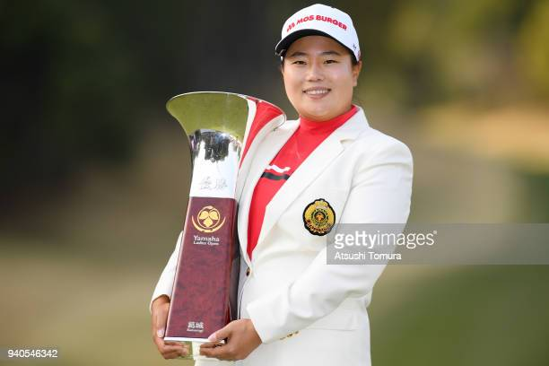 SunJu Ahn of South Korea poses with the trophy after winning the Yamaha Ladies Open Katsuragi at the Katsuragi Golf Club on April 1 2018 in Fukuroi...