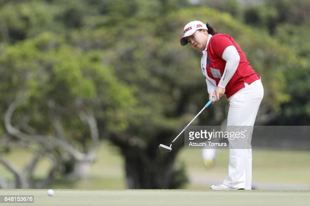 SunJu Ahn of South Korea putts on the 14th green during the final round of the Daikin Orchid Ladies Golf Tournament at the Ryukyu Golf Club on March...