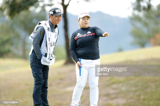SunJun Ahn of South Korea talks with her caddie on the 15th green during the first round of the TOTO Japan Classic at Seta Golf Course on November 02...