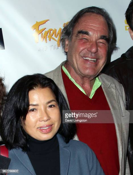Sunjung Jung and husband director Oliver Stone attend the premiere of Comedy Dynamics' The Fury of the Fist and the Golden Fleece at Laemmle's Music...