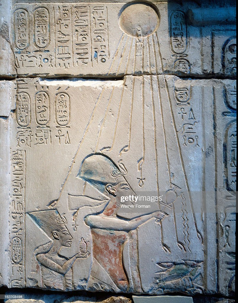 Sunk relief from the facade of a shrine showing Akhenaten and Nefertiti offering libations to Aten, the sun god : News Photo