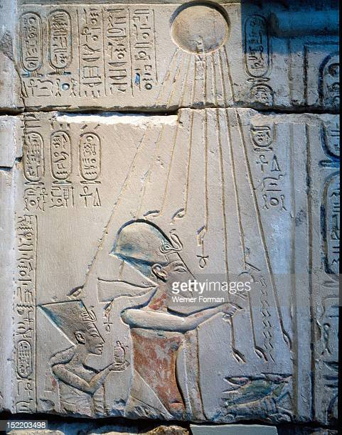 Sunk relief from the facade of a shrine showing Akhenaten and Nefertiti offering libations to Aten the sun god During the Amarna period shrines in...