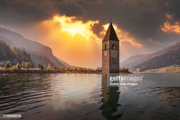 sunken bell tower in alpine lake - alto adige bildbanksfoton och bilder