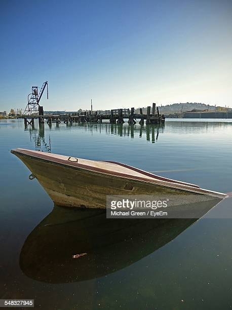 sunken boat in lake - sunken stock pictures, royalty-free photos & images