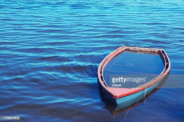sunken rowboat - sinking stock pictures, royalty-free photos & images