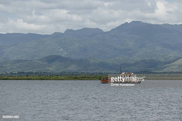 Sunken ship near Cuban coastline with a Topes de Collantes National park on a background