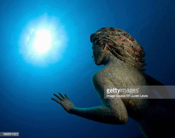 Sunken statue underwater