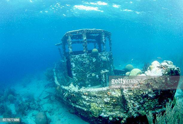 sunken tug in caracas bay - ship wreck stock pictures, royalty-free photos & images