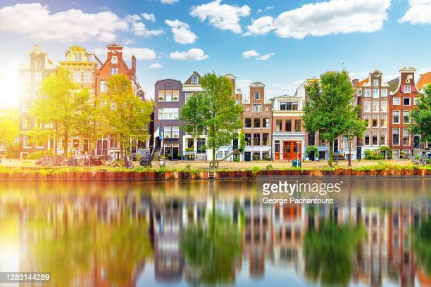 sunlight and architecture reflections in amsterdam, holland - amsterdam stock pictures, royalty-free photos & images