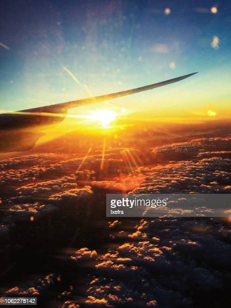Sunlight and cloudscape, view from the window seat of an airplane