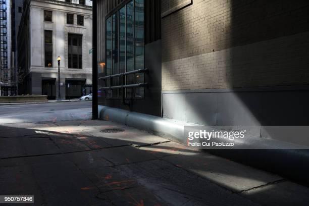 sunlight and shadow on the street of chicago downtown, illinois, usa - city life stock pictures, royalty-free photos & images