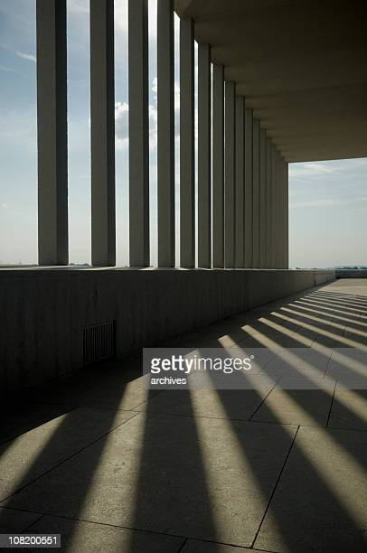 Sunlight and Shadows Through Columns of Building