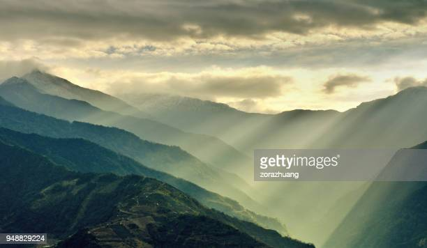 sunlight beams on mountain, taiwan - taiwan stock photos and pictures