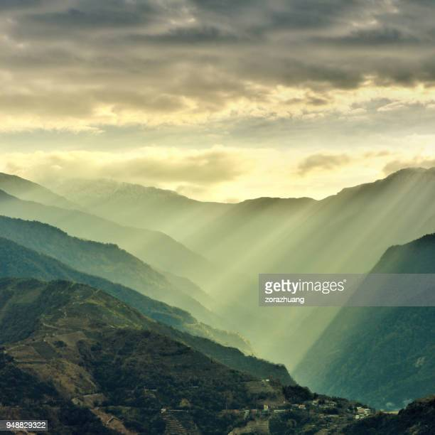 sunlight beams on mountain, taiwan - dramatic landscape stock pictures, royalty-free photos & images