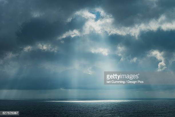 Sunlight coming through clouds on ferry between Dover and Calais