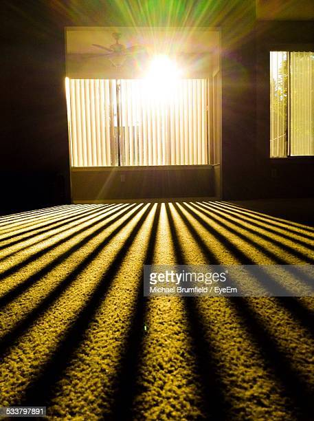 Sunlight Coming Through Window Blinds At Home