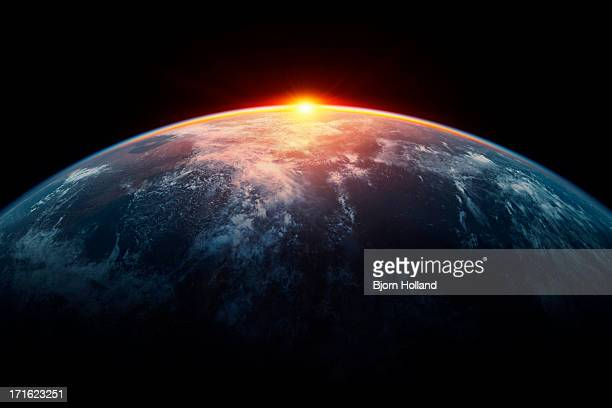 sunlight eclipsing planet earth - copy space stock-fotos und bilder