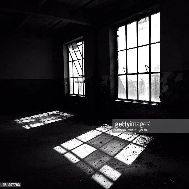 sunlight emitting through window in abandoned home - pomorskie province stock photos and pictures