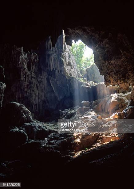 sunlight entering a cave in halong bay - quảng ngãi bildbanksfoton och bilder