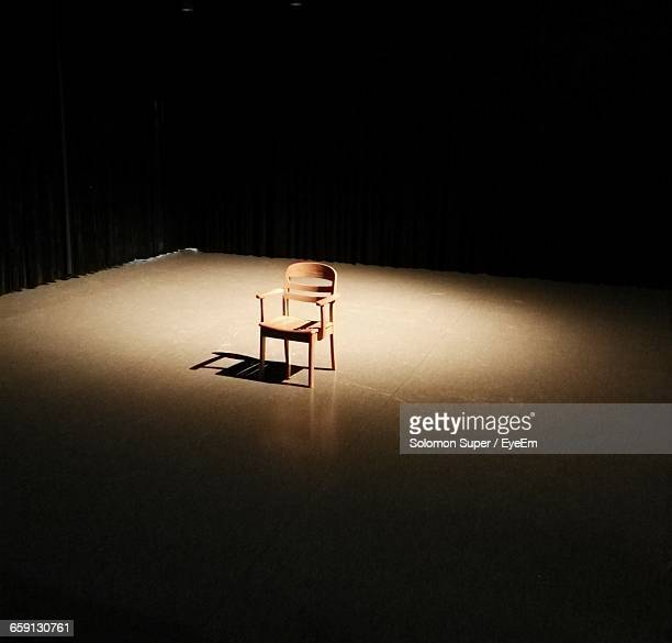 Sunlight Falling On Empty Chair In Room