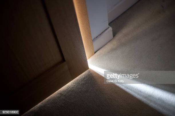 sunlight falling on floor through a door ajar - ajar stock pictures, royalty-free photos & images