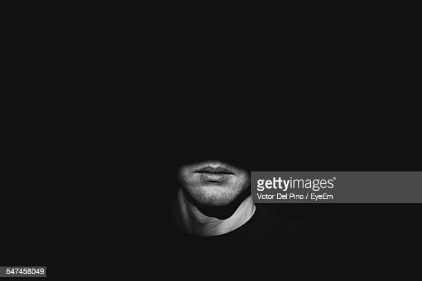 Sunlight Falling On Man In Darkroom