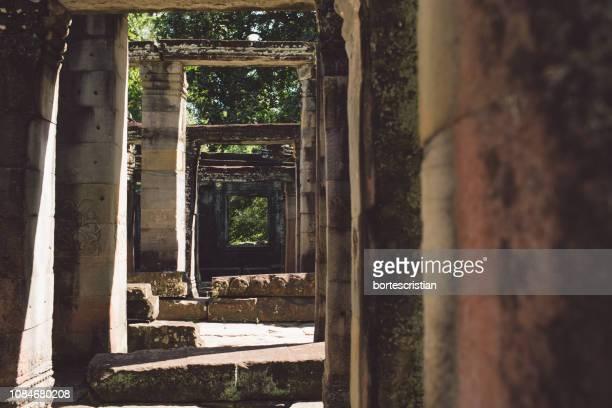 sunlight falling on old ruins - bortes ストックフォトと画像