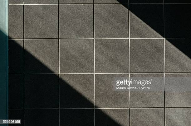 Sunlight Falling On Tiled Floor