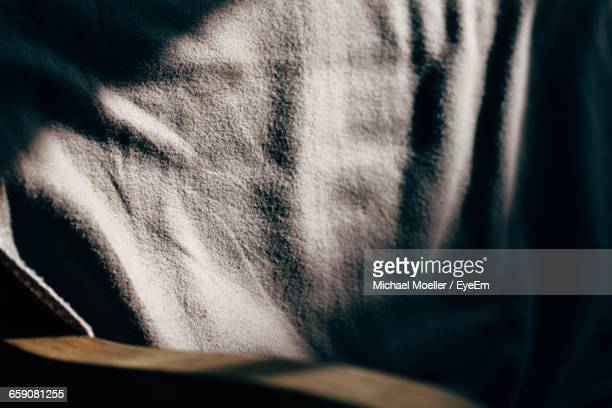 Sunlight Falling On White Fabric At Home