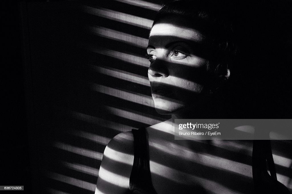 Sunlight Falling On Young Woman At Home : Stock Photo